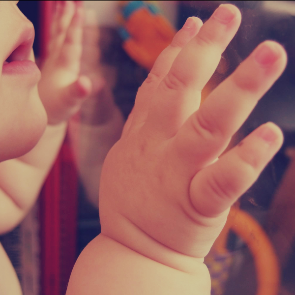 negative-space-baby-child-small-hands-martin-vorel